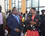 Executive Secretary-Oyesigye Onesmus (CPA) with the Minister of Education Hon. Janet Kataaha Museveni